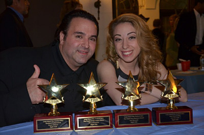 Sam Borowski (L) and actor Samantha Tuffarelli (R) display the 4 awards NIGHT CLUB won at the 28th Long Island Film Festival.