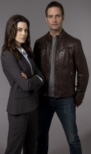 Josh Holloway as Gabriel Black and Meghan Ory as Riley Neal.