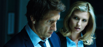 Detective Robbie Green (Jonathan LaPaglia) and Detective Jane Lambert (Viva Bianca) on the case in The Reckoning.