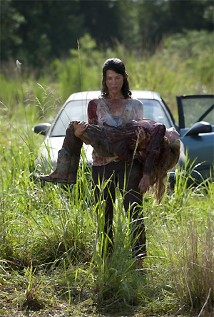 Audrey Marie Anderson and Meyrick Murphy in The Walking Dead.